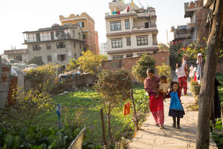rigid: KATHMANDU, NEPAL - CIRCA DEC, 2013: Unidentified local people near their home in a poor area of the city. The caste system is still intact today but the rules are not as rigid as they were in the past. Editorial