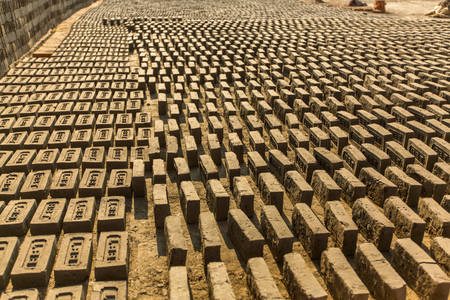 onsite: BHAKTAPUR, NEPAL - CIRCA DEC, 2013: On-site local Brick Factory. A survey found 74 kilns in the Bhaktapur district of KTM. In Kathmandu, respiratory problems occur at 12 times the national average.