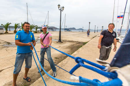 ellada: ANDROS, GREECE - CIRCA OCT, 2014: Sailors participate in sailing regatta 12th Ellada Autumn 2014 among Greek island group in the Aegean Sea, in Cyclades and Argo-Saronic Gulf. Editorial