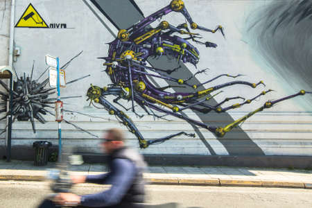 clashes: ATHENS, GREECE - APR 3, 2015: Contemporary graffiti art on city walls. Hardships of Greek economic crisis since 2010 have led to a new wave of graffiti - making Athens a new Mecca for street artists.