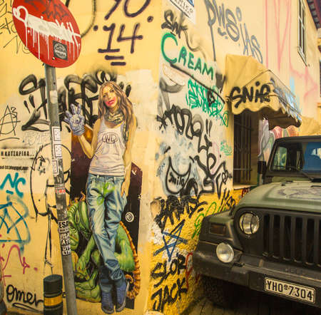 hardships: ATHENS, GREECE - APR 1, 2015: Contemporary graffiti art on city walls. Hardships of Greek economic crisis since 2010 have led to a new wave of graffiti - making Athens a new Mecca for street artists. Editorial