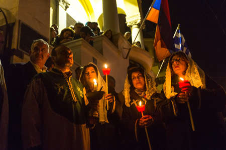 ATHENS, GREECE - APR 10, 2015: Unidentified people during the celebration of Orthodox Easter - Vespers on Great Friday (the Epitaphios in Greek served in Good Friday evening).
