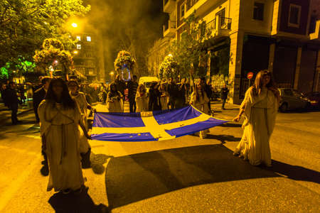 liturgical: ATHENS, GREECE - APR 10, 2015: Unidentified people during the celebration of Orthodox Easter - Vespers on Great Friday (the Epitaphios in Greek served in Good Friday evening).