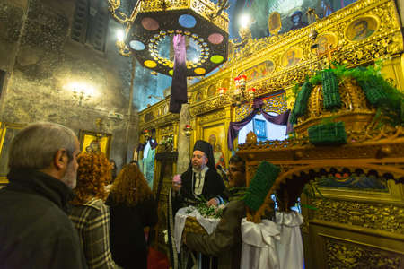 vespers: ATHENS, GREECE - APR 10, 2015: Unidentified people during the celebration of Orthodox Easter - Vespers on Great Friday (the Epitaphios in Greek served in Good Friday evening).