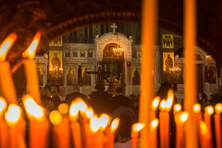 pascha: ATHENS, GREECE - APR 12, 2015: Unknown people during celebration of Orthodox Easter (Midnight Office of Pascha) Holy Saturday is often the only time that the Midnight Office will be read in parishes. Editorial