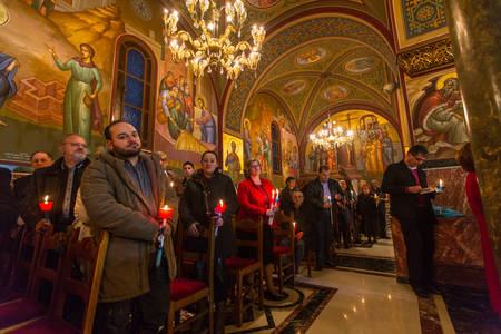 liturgical: ATHENS, GREECE - APR 12, 2015: Unknown people during celebration of Orthodox Easter (Midnight Office of Pascha) Holy Saturday is often the only time that the Midnight Office will be read in parishes. Editorial