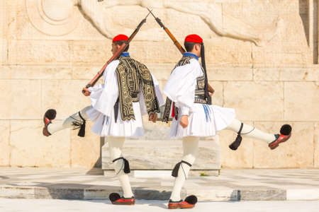 evzones guard: ATHENS, GREECE - APR 13, 2015: Greek soldiers Evzones (or Evzoni) dressed in full dress uniform, refers to the members of the Presidential Guard, an elite ceremonial unit, active from 1833 - present. Editorial