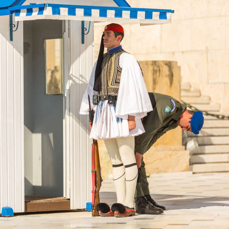 ceremonial: ATHENS, GREECE - APR 13, 2015: Evzone guarding the Tomb of the Unknown Soldier in Athens dressed in full dress uniform, refers to the members of the Presidential Guard, an elite ceremonial unit.