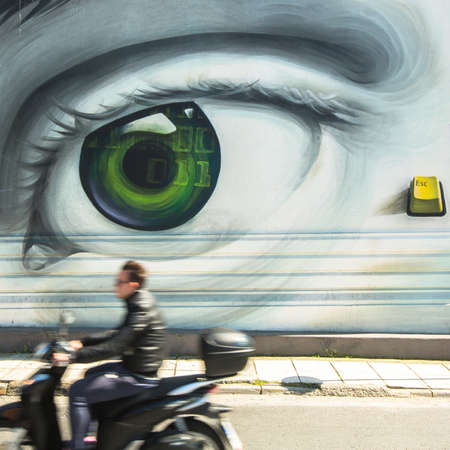 hardships: ATHENS, GREECE - APR 3, 2015: Contemporary graffiti art on city walls. Hardships of Greek economic crisis since 2010 have led to a new wave of graffiti - making Athens a new Mecca for street artists.