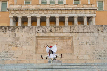 evzones guard: ATHENS, GREECE - APR 12, 2015: Greek soldiers Evzones (or Evzoni) dressed in full dress uniform, refers to the members of the Presidential Guard, an elite ceremonial unit, active from 1833 - present.