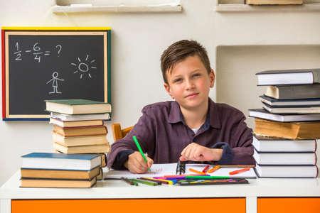 junior student: Junior student does homework. Stock Photo