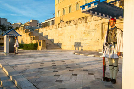 tomb of the unknown soldier: ATHENS, GREECE - APR 12, 2015: Evzone guarding the Tomb of the Unknown Soldier in Athens dressed in full dress uniform, refers to the members of the Presidential Guard, an elite ceremonial unit.