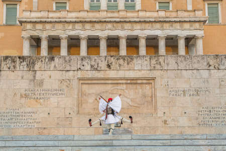 evzone: ATHENS, GREECE - APR 12, 2015: Evzone guarding the Tomb of the Unknown Soldier in Athens dressed in full dress uniform, refers to the members of the Presidential Guard, an elite ceremonial unit.
