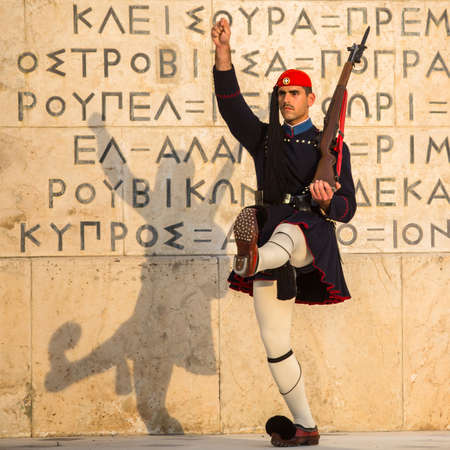 evzone: ATHENS, GREECE - APR 14, 2015: Evzone guarding the Tomb of the Unknown Soldier in Athens dressed in service uniform, refers to the members of the Presidential Guard, an elite ceremonial unit.