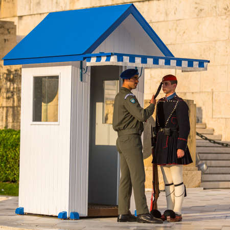 tomb of the unknown soldier: ATHENS, GREECE - APR 14, 2015: Evzone guarding the Tomb of the Unknown Soldier in Athens dressed in service uniform, refers to the members of the Presidential Guard, an elite ceremonial unit.