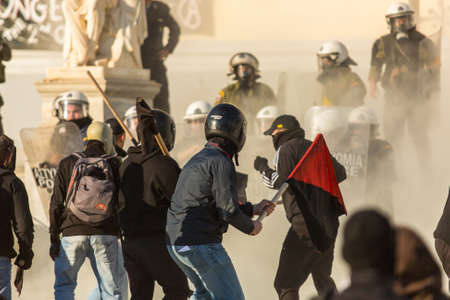 riots: ATHENS, GREECE - APR 16, 2015: Anarchist protesters near Athens University, which has been occupied by protesters - voiced support for a hunger strike by prisoners convicted under anti-terrorism laws. Editorial