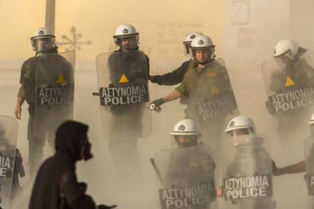 convicted: ATHENS, GREECE - APR 16, 2015: Anarchist protesters near Athens University, which has been occupied by protesters - voiced support for a hunger strike by prisoners convicted under anti-terrorism laws. Editorial