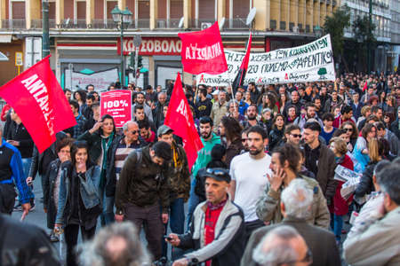 anarchist: ATHENS, GREECE - APR 16, 2015: Anarchist protesters near Athens University, which has been occupied by protesters - voiced support for a hunger strike by prisoners convicted under anti-terrorism laws. Editorial