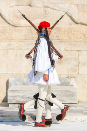 tomb of the unknown soldier: ATHENS, GREECE - APR 13, 2015: Evzone guarding the Tomb of the Unknown Soldier in Athens dressed in full dress uniform, refers to the members of the Presidential Guard, an elite ceremonial unit.