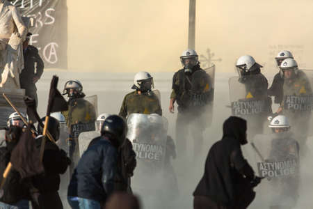 clashes: ATHENS, GREECE - APR 16, 2015: Leftist and anarchist groups seeking the abolition of new maximum security prisons, clashed with riot police, who responded with tear gas and stun grenades.