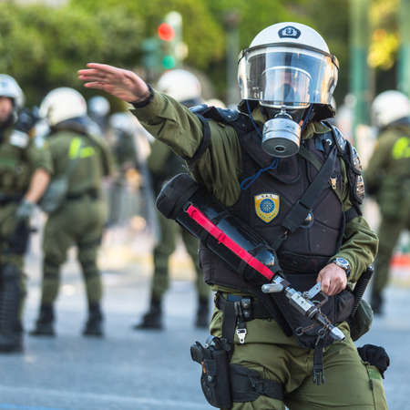 riots: ATHENS, GREECE - APR 16, 2015: Leftist and anarchist groups seeking the abolition of new maximum security prisons, clashed with riot police, who responded with tear gas and stun grenades.