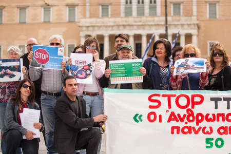 protesters: ATHENS, GREECE - APR 18, 2015: Unidentified protesters during the World Day of Action against TTIP CETA TISA, (Transatlantic Trade and Investment Partnership) in Athens near presidential Palace. Editorial