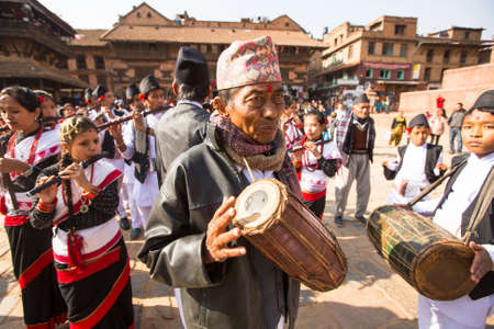7 months: BHAKTAPUR, NEPAL - CIRCA DEC, 2013: Unidentified musicians during Birthday celebration head of family - 77 years 7 months 7 days 7 hours old, like rebirth according to Newar. Editorial