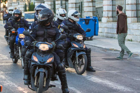 riots: ATHENS, GREECE - APR 16, 2015: Riot police on motorcycles during a rally in front of the Athens University, which is under occupation by the protesters and leftist anarchist groups.