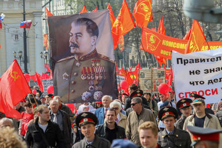 dictator: MOSCOW, RUSSIA - MAY 1, 2010: During the celebration of May Day. Communist party supporters take part in a rally. (portrait of Soviet dictator Josef Stalin)