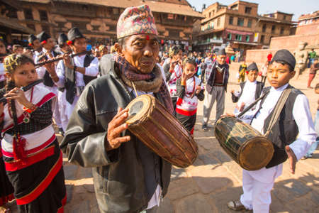 20 years old: BHAKTAPUR, NEPAL - DEC 20: Unidentified musicians during Birthday celebration head of family - 77 years 7 months 7 days 7 hours old, like rebirth according to Newar, Dec 20, 2013 in Bhaktapur, Nepal.