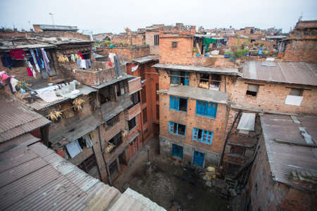 rotates: BHAKTAPUR, NEPAL - CIRCA DEC, 2013: Houses in the Central district of Bhaktapur. More 100 cultural groups have created an image of Bhaktapur as Capital of Nepal Arts.