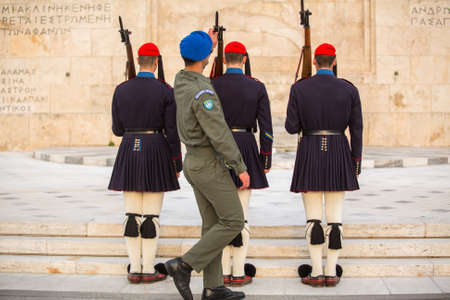 evzones guard: ATHENS, GREECE - APR 14, 2015: Greek soldiers Evzones (or Evzoni) dressed in service uniform, refers to the members of the Presidential Guard, an elite ceremonial unit, active from 1833 - present.