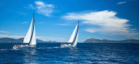 Sailing in the wind through the waves at the Aegean Sea in Greece.