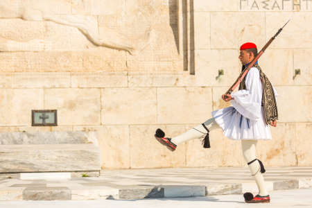 evzone: ATHENS, GREECE - APR 13, 2015: Evzone guarding the Tomb of the Unknown Soldier in Athens dressed in full dress uniform, refers to the members of the Presidential Guard, an elite ceremonial unit.