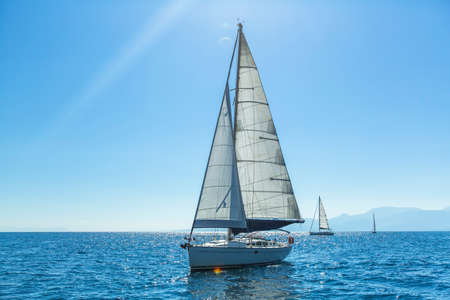 sailing: Ship yachts with white sails in the open Sea. Sailing. Luxury boats.
