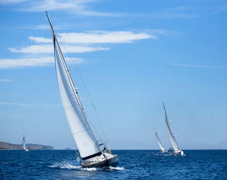 Boats in sailing regatta. Yachting. Luxury yachts.