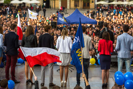 demonstrators: KRAKOW, POLAND - APR 29, 2015: During the rally of the presidential candidate of Poland - Janusz Korwin-Mikke - creator of a Polish liberal political party Coalition for the Renewal of the Republic.