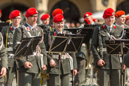 public holiday: KRAKOW, POLAND - MAY 3, 2015: Military Band on main square of Krakow during annual Polish national and public holiday the Constitution Day. May 3, 1791 was adopted first Constitution of modern Europe.