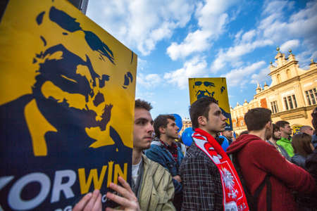 political party: KRAKOW, POLAND - APR 29, 2015: During the rally of the presidential candidate of Poland - Janusz Korwin-Mikke - creator of a Polish liberal political party Coalition for the Renewal of the Republic.