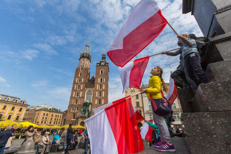 Polonia: KRAKOW, POLAND - MAY 2, 2015: During Flag Day of the Republic of Polish - is national festival introduced by the Act of 20 Feb 2004. On the same day is celebrated Day of Polonia and Poles Abroad.
