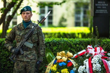 public holiday: KRAKOW, POLAND - OCT 3, 2015: Polish soldiers at ceremony of laying flowers to monument to Hugo Kollataj during annual Polish national and public holiday the May 3rd Constitution Day (of May 3, 1791)