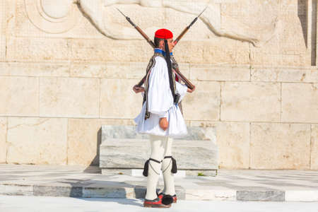 ATHENS, GREECE - APR 13, 2015: Greek soldiers Evzones (or Evzoni) dressed in full dress uniform, refers to the members of the Presidential Guard, an elite ceremonial unit, active from 1833 - present. Editorial