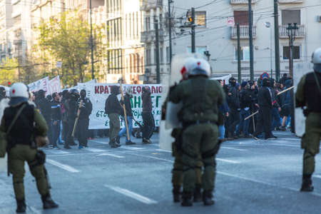 austerity: ATHENS, GREECE - APR 16, 2015: Leftist and anarchist groups seeking the abolition of new maximum security prisons, clashed with riot police, who responded with tear gas and stun grenades.