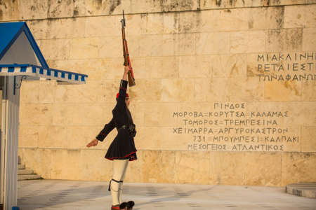 evzone: ATHENS, GREECE - CIRCA APR, 2015: Evzone guarding the Tomb of Unknown Soldier in Athens dressed in service uniform, refers to the members of the Presidential Guard, an elite ceremonial unit.