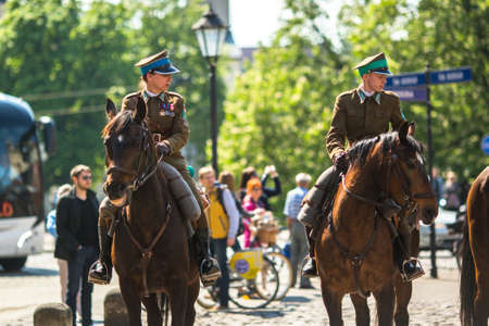 public holiday: KRAKOW, POLAND - MAY 3, 2015: Polish cavalry during annual of Polish national and public holiday the May 3rd Constitution Day. Holiday celebrates declaration of the Constitution of May 3, 1791.