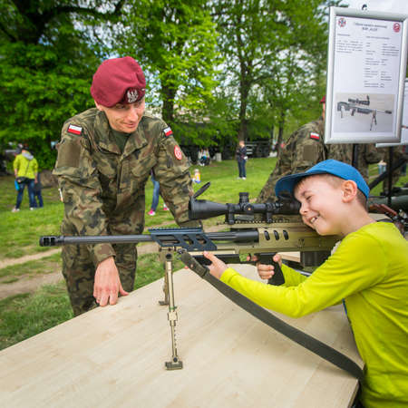 akm: KRAKOW, POLAND - MAY 3, 2015: Unidentified child during demonstration of the military and rescue equipment during annual Polish national and public holiday the Constitution Day May 3rd.
