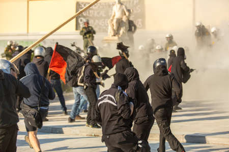 responded: ATHENS, GREECE - APR 16, 2015: Leftist and anarchist groups seeking the abolition of new maximum security prisons, clashed with riot police, who responded with tear gas and stun grenades.