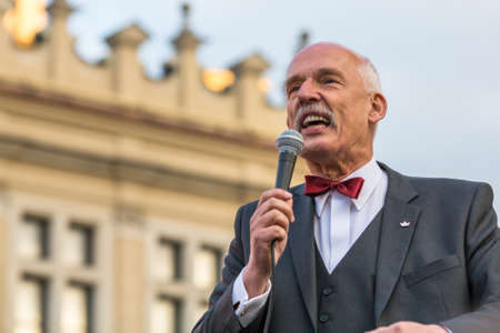 conservative: KRAKOW, POLAND - APR 29, 2015: Janusz Korwin-Mikke or JKM, is a conservative liberal Polish politician, during pre-election rally of presidential candidate of Poland, on main square Krakow.