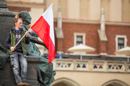 Polonia: KRAKOW, POLAND - MAY 2, 2015: National Flag Day of the Republic of Poland (by the Act of 20 Feb 2004) celebrated between the holidays: May 1st (Labour Day) and May 3rd - Feast of Polish Constitution. Editorial