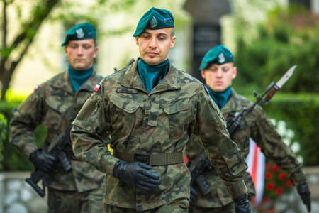 public holiday: KRAKOW, POLAND - MAY 3, 2015: Polish soldiers at ceremony of laying flowers to monument to Hugo Kollataj during annual Polish national and public holiday the May 3rd Constitution Day (of May 3, 1791)
